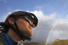 Rainbow cyclist Stock Photos