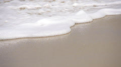 SLOW MOTION: Waves sliding along the sandy beach Stock Footage