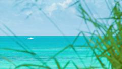 Boat on Tropical Ocean Seen from Bermudan Island Stock Footage