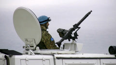 Italian UN soldier on military vehicle machine gun MG42 Stock Footage