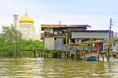 stilt houses of kampong ayer and sultan omar ali saifudding mosque, brunei - stock photo