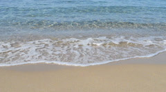 Blue water and golden shore Stock Footage