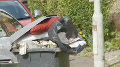 Overloaded wheelie bin (close up) Stock Footage