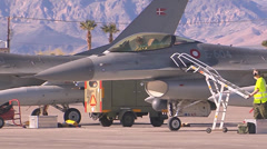 A Royal Danish Air Force F-16AM pilot opens the canopy Stock Footage