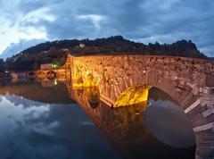 Devils Bridge at Night in Lucca, Italy Stock Photos