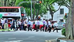 Office Workers Crossing Busy Road in Singapore Stock Footage
