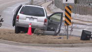 Stock Video Footage of Vehicle accident on slippery road, van off road into pole