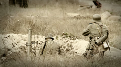 German soldiers shooting with a rifle and mortar in trench . WWII old film movie Stock Footage
