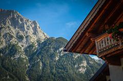 Traditional alpine chalet Stock Photos
