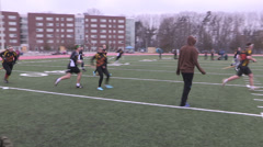 College and university quidditch game outdoors in winter on campus. Stock Footage