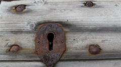 rusty lock on the wooden shingle - stock footage