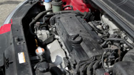 Stock Video Footage of Car engine bay, starting the motor of a compact car