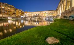 Stunning skyline of florence with ponte vecchio and arno river at dusk Stock Photos