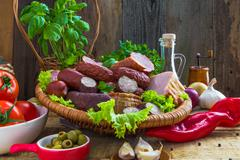 assortment meats sausage bacon vegetables - stock photo
