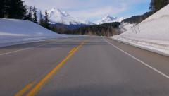 Driving North in Snowy Mountains Scenic Road on Sunny Day Stock Footage