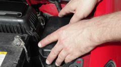Engine bay - replacing a fuse in the car Stock Footage