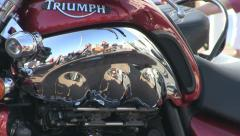 Triumph motorbike with bikers in reflection Stock Footage
