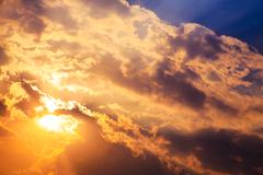 Stock Photo of beautiful bright sunset with cumulus clouds.