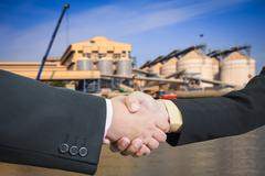 businessman handshake with silo transportation logistic background - stock photo