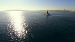 Fly over Bosphorus Sea towards Maidens Tower at sunset Stock Footage