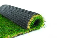 Artificial turf green grass roll on white background Stock Photos