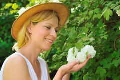 Young woman gardening - taking care of snowball Stock Photos