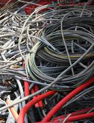 cables and copper cables in a container for recycling of materials 3 - stock photo