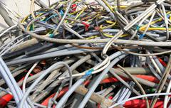 cord amassed in a container in special waste landfill - stock photo