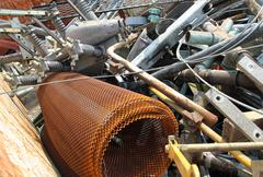 Piles of scrap iron with broken and rusted objects Stock Photos