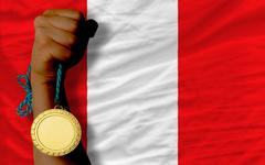 gold medal for sport and  national flag of peru - stock photo