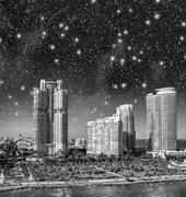 night over miami. starry sky above city buildings - florida - usa - stock photo