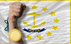 gold medal for sport and  flag of american state of rhode island - stock photo
