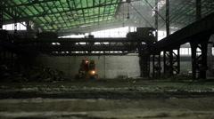 Construction machine inside industrial interior Stock Footage