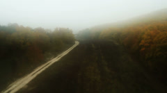 Aerial View: Flying over the forest in a fog, near Bakhchisaray, Crimea Stock Footage
