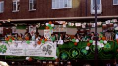 Birmingham's St Patrick's Day parade 2014- people on the truck across the street Stock Footage