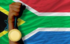 gold medal for sport and  national flag of south africa - stock photo