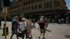 Pedestrians cross road at william street and hay street, perth, australia Stock Footage
