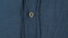 Young Man Unbuttoning A Blue Shirt Close-Up Stock Footage