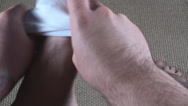 Stock Video Footage of Young Man Putting White Socks On His Feet Point Of View