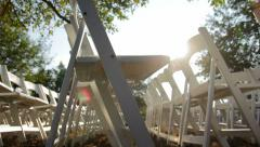 White Folding Chairs Sun Flare - stock footage
