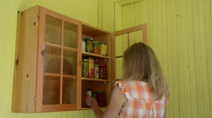 Woman put pot canned pickled food products to storage rack Stock Footage