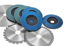 Circular saw blades and abrasive disks  isolated on white Stock Photos