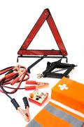 Emergency kit for car - first aid kit, car jack, jumper cables, warning triangle - stock photo