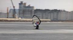 Windsurfing on the ice Stock Footage