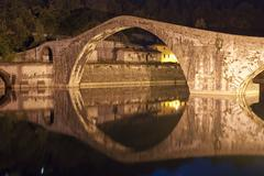 Devils Bridge at Night in Lucca, Italy Stock Photos