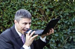Business Man Outdoor Desperate with his Notebook Stock Photos