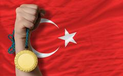 Stock Photo of gold medal for sport and  national flag of turkey