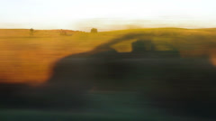 Travelling tracking the shadow of a car Stock Footage