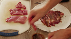 Chef marinating steak slices with dark sweet marinade Stock Footage