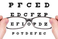 sight test seen through eye glasses - stock photo